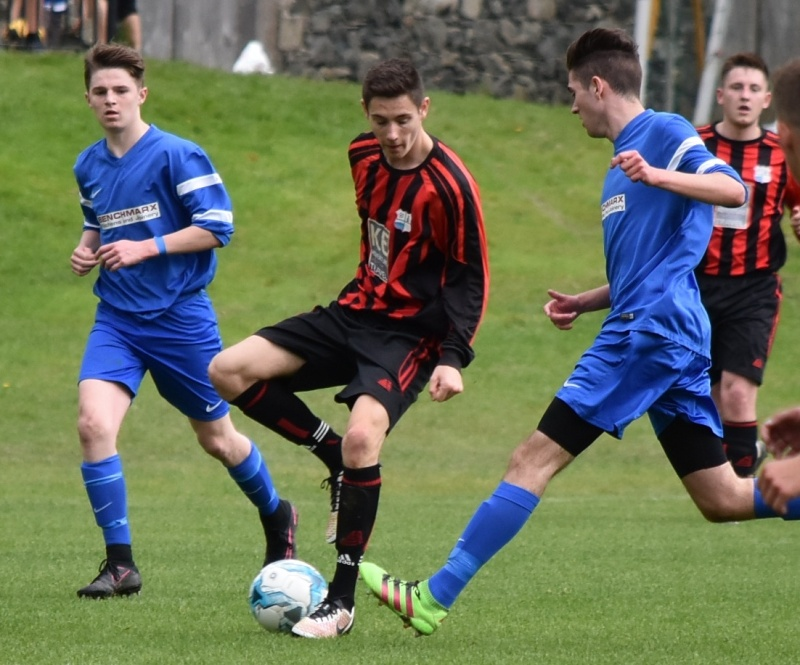 Keswick Reserves v Castletown United - Charlie Robson takes on Ewan Willacy and Ryan Gate (Ben Challis)
