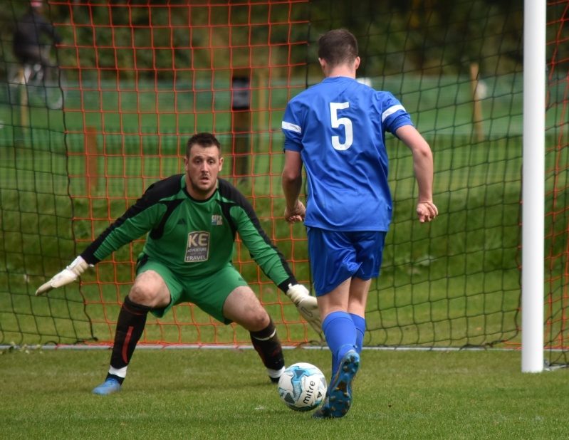 Keswick Reserves v Castletown United - Searus Aynsley heads for John Philip's goal (Ben Challis)